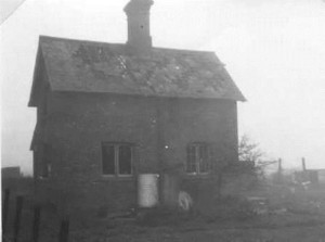 The cottage on the opposite side of the railway damaged by plane from RAF Glatton slewing across the railway line in 1944.