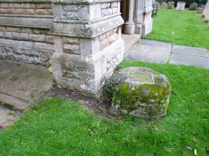 The base of the cross outside the porch of Holme church.
