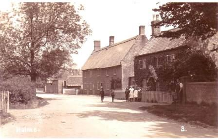 The house to the right was occupied by Mr Chapman, the water engineer.  The village pump was on the opposite side of the road on the corner of Park Close.  Water was piped to the pump from Stilton Spring Farm.